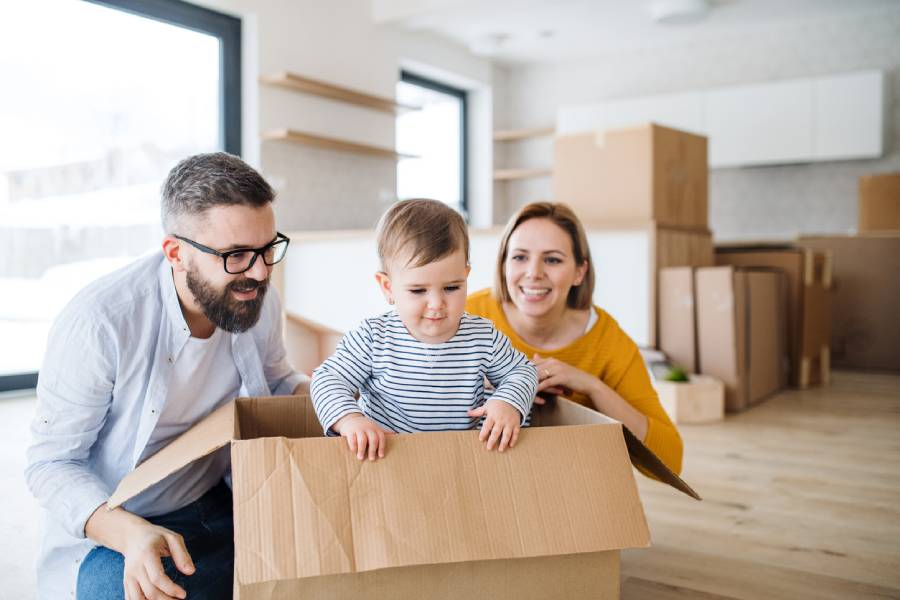 family unpacking and happy in new home