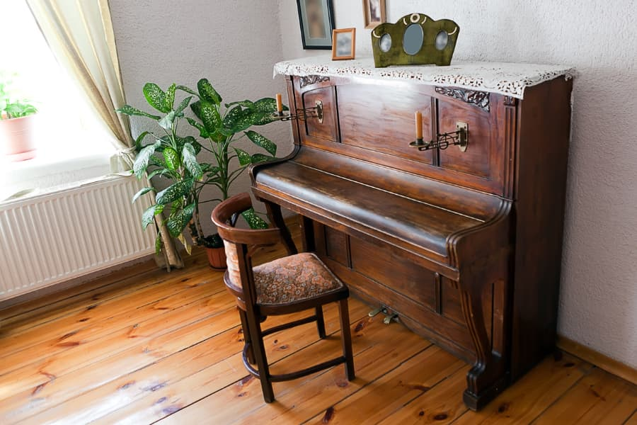 antique piano in living room setting
